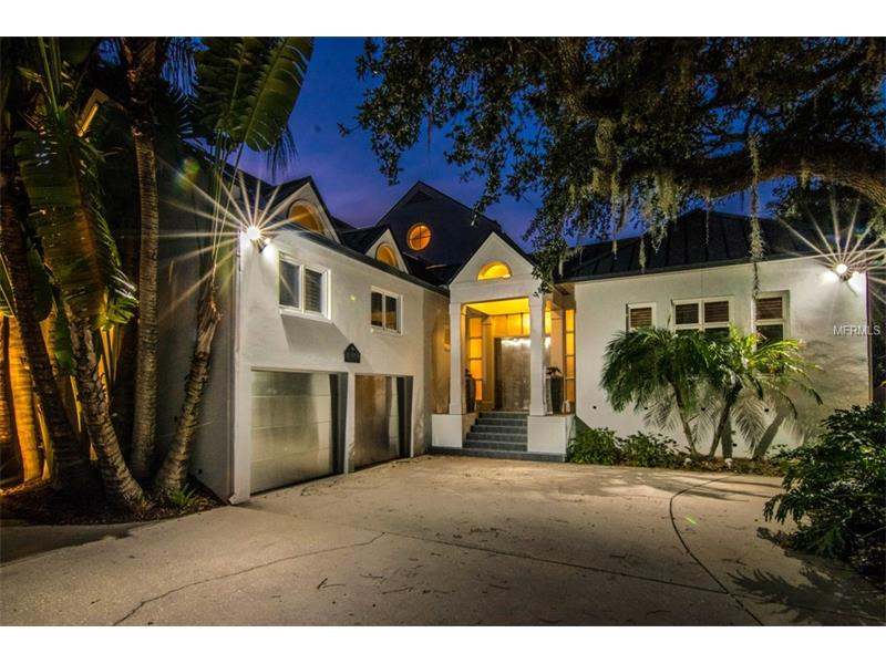 This one of a kind Ballast Point contemporary home is located on a quiet cul de sac just off of Bayshore Boulevard. This gorgeous 3 bedroom 3 bath home is set back behind a landscaped circular drive with a 2 car parking garage with unique stainless steel doors. The entryway is met with the view of a spectacular pool and large waterfall as well as an outside shower. The kitchen is open to a large living room where you can appreciate the beautiful courtyard waterfall views. Also on the main floor is a large bedroom and bathroom as well as formal dining area. The master bedroom sits up on its own floor with an expansive bathroom with large bathtub, separate shower, and dual sink and large walk in closet. The third bedroom sits off on its own wing and floor as well allowing for a private feel to each room.