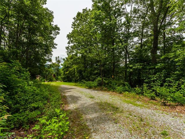 One and a half acres of year-round mountain views is waiting for you! Lot is located in the Stoneridge Estates development, minutes from Bat Cave, Chimney Rock and Lake Lure. There is plenty of space to build your dream home on this gently sloped, wooded lot. Previously approved for three bedroom septic.