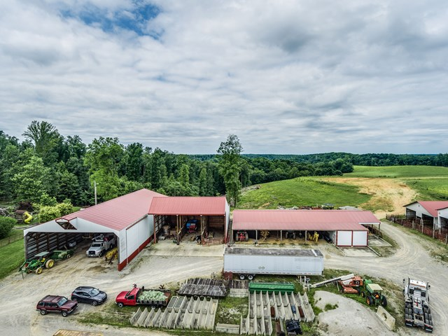 Great development tract or cattle farm, with 70.79 rolling acres, very private, trees, beautiful building spots, pastures, plus 5 metal buildings ready for you to make this property your own.
