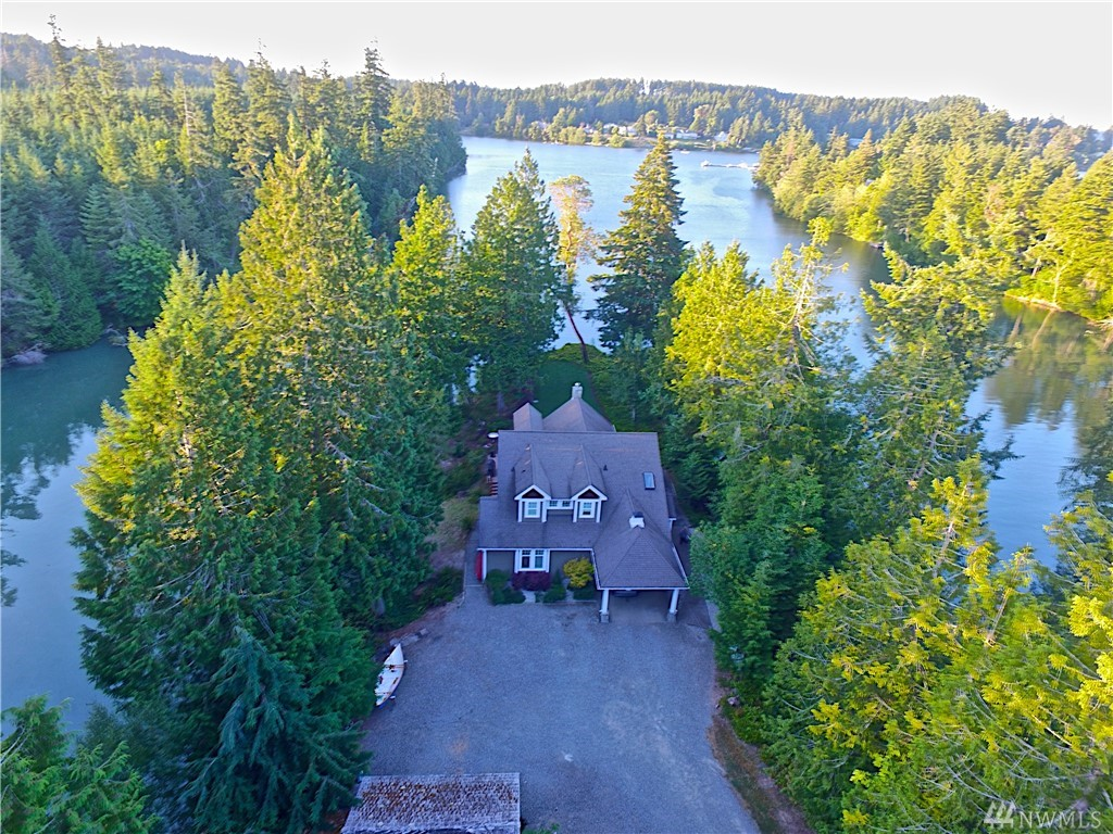 Enjoy living in this beautiful custom home by one of Olympia's top builders along w/an exquisite guest house. Surrounded by 900±ft of waterfront on Wildcat Cove.(You own the point!) Main home features custom cabinetry, hdwd/tile floors, honed granite counters & SS appliances. Main level Mstr bdrm. Guest/MIL home is an all cedar craftsman built to the same meticulous standards w/granite counters, subzero fridge & custom built-ins. Lrg bedrm, 1.5 ba. Private dock/boat launch. A rare find.