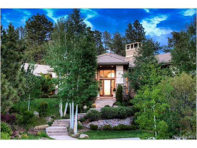 """This exclusive Castle Pines Village Estate features spectacular Colorado mountain sunset views from the front and tranquil resort living in the rear. The home was perfectly designed on 1.36 acres to integrate into the Colorado landscape with unrivaled outdoor living. Multi-directional waterfalls, grill cabana, extensive stone sitting areas and sweeping landscaping provides a gorgeous oasis for entertaining. The newly designed Executive Retreat/Man Cave or Nanny quarters with separate entrance features a gorgeously detailed board room, bathroom and kitchen. Each room is abundant with detail and executive style living. The home includes a stunning theatre, rec room, exercise room and bar in the basement. The recently added """"man cave"""" make this home unique and a place to park your Harleys! No details were spared in the construction and remodel of this exquisite estate. Truly a """"one-of-a-kind"""" find in Castle Pines Village. Must see today!"""