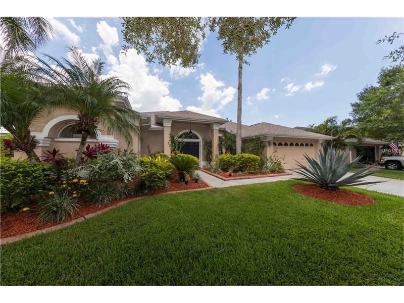 Serene, beautifully kept POOL/SPA home in highly regarded Tampa, FL neighborhood of Westchase new on the market!  Positively TURN-KEY - this CUL-DE-SAC home exudes PRIDE IN OWNERSHIP… from lovingly manicured landscaping to BRAND NEW June, 2017 ROOF; all new pool surfaces (marcite/patio) and pool equipment - the outdoor spaces may set one's expectations high! The COVERED LANAI, screened in patio; custom landscaping with WATERFALL is perfect outdoor living space connecting beautifully to Indoors. Indeed, the Interior living space, offers 2100 sf, 3 bed/2 bath is immaculate, ELEGANT and so calming. Very comfortable split floor plan, that beautifully EMBRACES the outdoors, offers OPEN KITCHEN to FAMILY ROOM space, as well as welcoming Living Room/Dining room  (with coat closet!) and separate Master Suite/2 secondary bedrooms. Master Suite is a very generous room with spectacular closet space (2 separate closets+linen). Appointed with beautiful PLANTATION SHUTTERS thru-out, CROWN MOLDING, gas FIREPLACE, upgraded cabinetry, GRANITE countertops in kitchen and baths, high end appliances incl newer gas stove and Bosch dishwasher.  BRAND NEW 50 gallon gas hot water heater just installed, June 2017.  Westchase is a planned development in Tampa, FL offering fabulous amenities that include 2 Swim & Tennis Centers, parks, playgrounds, tons of sidewalks, gorgeous common grounds and a town center loaded with great variety of restaurants and shops, creating a true COMMUNITY where one will love to come HOME to every day.