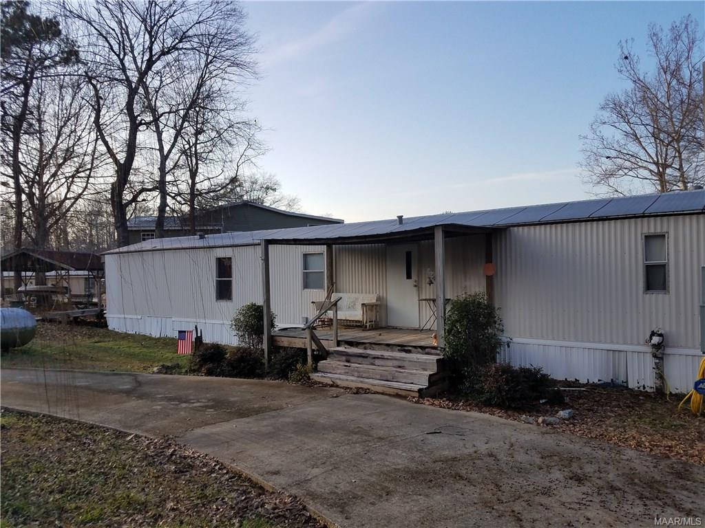 Mobile home on Lake Martin with beautiful view! Property has circular drive, deck off of mobile home, and beautiful view of Lake Martin.