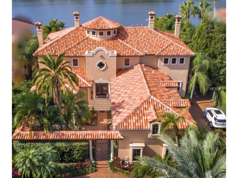 This beautiful Mediterranean mansion is on The Pointe of Harbour Island near Downtown, Bayshore & Channelside. A rare private secure island with 2 manned gated entrances. This is 1 of 9 homes behind the secondary electric gate where only 2 homes in the history of the Pointe have been available for re-sale. On a DEEP water channel to the open bay with a 16,000 lb capacity boat lift & floating moorings to accommodate large yachts. Zillow has details.