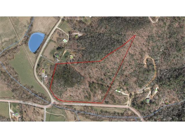 This parcel of land consists of 10.6 acres located at the intersection of Huntley and North Bearwallow roads in the Fletcher Township. It is heavily wooded and has several home building sites. It is convenient to both Asheville and Hendersonville, and is within 20 minutes of the Asheville Airport. There is a high knoll on the property which would be a great location for a gazebo to enjoy the beautiful views of mountains. This includes great views of Burrell Hollow and the Hoopers Creek valley.