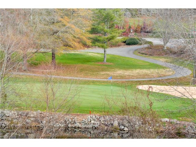 Beautiful lot overlooking Etowah Country Club North Course hole #9 which includes a pond.  Great easily buildable lot.  This is GREAT property.  We have builders that can build for you if you don't have a builder.  Call today for a showing.