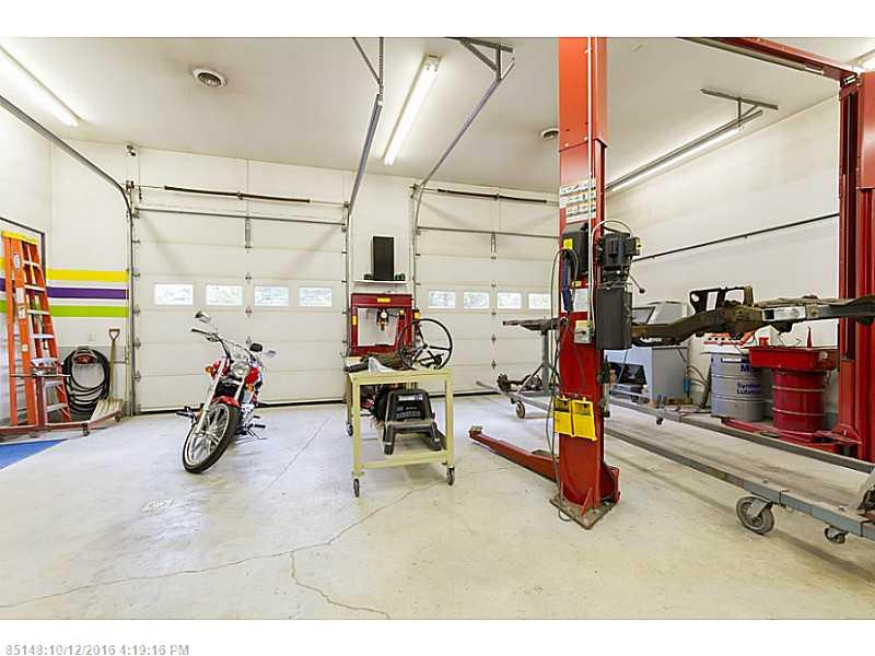 IDEAL LOCATION!  High traffic & visibility make this an outstanding opportunity! Quality built, turn-key building is just waiting for your new business.  Insulated w/ 8, 10, 14 ft ceilings, 4 bays, spray booth, office, showroom.  This is not your typical garage... immaculate - a must see!  Perfect for retail or other business.