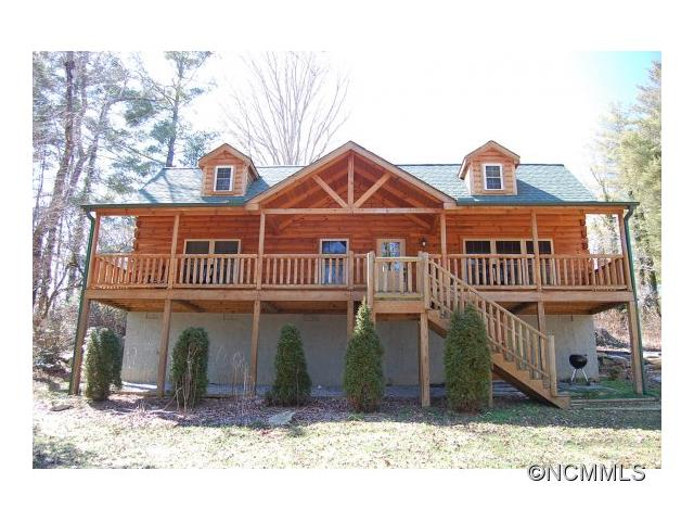 FIRST PRICE REDUCTION!!!...EXCELLENT RENTAL HISTORY for this Classic Log Home at OSCEOLA LAKE.  MAIN ST. Shopping, Dining, Theater, Music etc. or Canoe, Fish and Hike around this Delightful Lake or Just Sit and Rock on the 45Ft. Covered Front Porch, enjoying the Peace and Tranquility. Great Present Income Opp. Avail for Long term lease. Appropriately furnished and waiting for YOUR inspection.