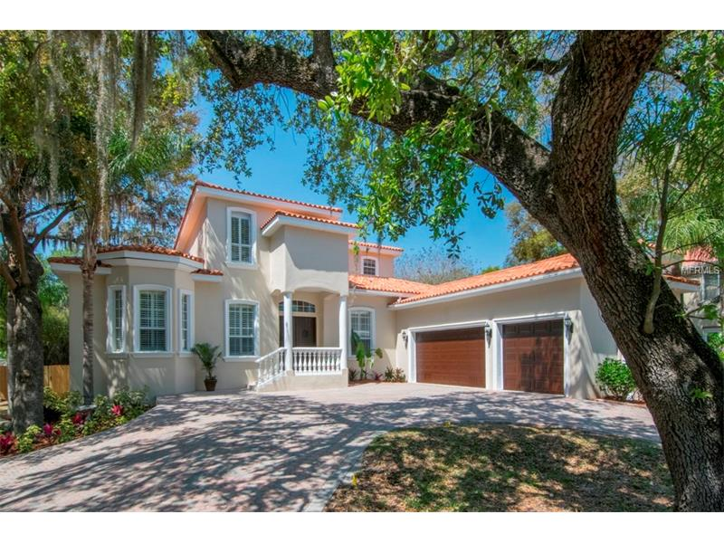 Beautifully done home located on prestigious Bayshore Blvd.  This home has it all: HUGE 87x207 foot lot, 3 car garage, first-floor master suite, 14-foot ceilings, bonus rooms, media room, pool, hot tub, and plenty of extra yard space!  You won't be disappointed with all the features this home has to offer.  All new travertine flooring throughout the living areas, and new carpeting in the bedrooms.  The first floor features a formal dining room which connects to the enormous kitchen with a cooking island and a gas cook top.  The kitchen has an eating nook with seamless glass looking out over the pool area and an expansive back yard.  The kitchen is open to the large family room with gas fireplace.  The split plan features the office and master suite on one side of the home with walk-in shower, Jacuzzi tub and an oversized walk-in closet.  On the other side of the home are 3 guest bedrooms and 2 full baths.  Upstairs is a huge loft area, 1 more bedroom, a full bath and a media room/bonus room.  Truly a great home!