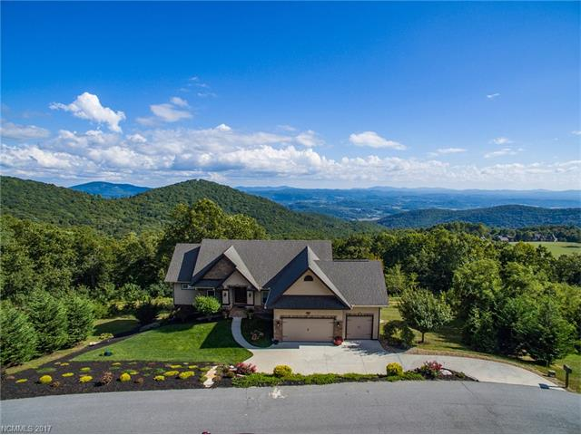 Spectacular panoramic long range views! Enjoy outdoor living on 60 foot raised deck with fireplace. You'll see  Deer, Turkey, soaring Hawks, etc. Horses on site in picturesque pastures!  Asheville, Hendersonville and Lake Lure (each 25 min. drive). Home features 3 bedrooms, 3 full baths, chef's kitchen, stainless, granite,  cooktop, ovens,  beautiful island. Workout room, hobby room, & 3 car garage. Active community with interests being shared, cooking, books, hiking, tennis, golf outings, etc.