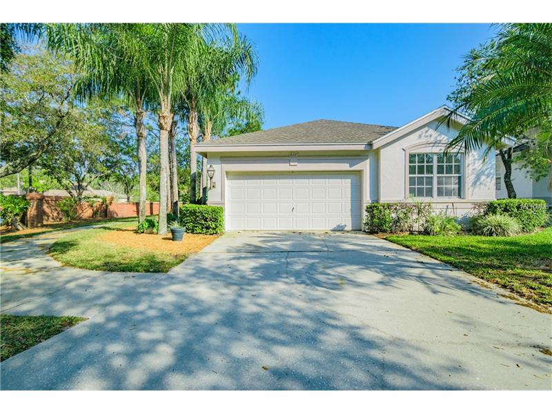 Imagine, a world where your back yard is the four star rated Westchase Golf Club.    Welcome home to your completely renovated Westchase Golf Community paradise.  This beautiful 3 bed 2 bath home features a complete renovation including new kitchen and baths, upgraded tile, cabinetry, floor coverings, etc, etc.  The Roof was replaced in 2015.  The home features inside laundry with a washer and dryer included.    Park your cars and golf cart in the spacious two car garage and get caught up with your work in the bonus room / office in the front overlooking Glencliff Park.  Play baseball, tennis or soccer in this spacious park that is literally right across the street.  Stressed out after a long day? Enjoy the luxurious spa located right out your back door overlooking the golf course green.  Pool, Tennis and Golf access are available for an additional fee which can be determined by contacting the Westchase Community Association.  Measurements are estimated, buyer must verify all room dimensions  Ask your agent for the website link that leads directly to the HOA to find out more about their requirements and fees.  Several Neighborhoods in Westchase have sub-Associations that govern them as well as being governed by the Westchase Community Association.  Glencliff has its own Homeowner's Association which is considered a sub-association.  Glencliff residents pay Westchase Homeowner's Association dues plus Glencliff monthly maintenance which includes exterior painting and lawn maintenance.