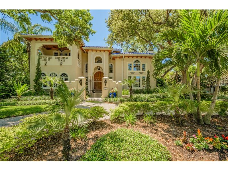 Welcome to this impeccably appointed Tuscan estate just off of Bayshore Boulevard. Downstairs boasts travertine floors & new Venetian plaster walls. The foyer features a 20 ft ceiling. The living room boasts custom painted ceilings & an inviting gas fireplace.  The theater room is multi purpose & serves well for entertaining and features full screen with LED projector, electric shades & state of the art equipment. The eclectic bar leads to the 1st butlers pantry with dishwasher, ice maker, refrigerator & granite counter tops. The elegant dining room with its soaring 20 foot ceiling has a magnificent view of the patio/pool. The 2nd butlers pantry includes a wet bar, refrigerated drawers, dishwasher & granite. The Chefs kitchen is the heart of the home. The gourmet kitchen boasts a center island as well as an expansive breakfast bar. Honed marble counters, stainless sinks, Wolf microwave, wall oven, range, warming drawer, refrigerator, freezer are all part of this incredible kitchen. This beauty overlooks the inviting family room, dining area and custom pool and spa. A 600 bottle wine room and 300 bottle tasting room are an oenophiles dream come true.Take the winding front staircase from the foyer, stairs from the family room or the elevator to the second floor. The master suite has a two-way fireplace, garden tub & walk-in shower.  Also on the 2nd floor are 4 additional bedrooms, a full kitchen & bonus room. This magnificent home is ideal for elegant entertaining & the added value of a mother-in-law suite.