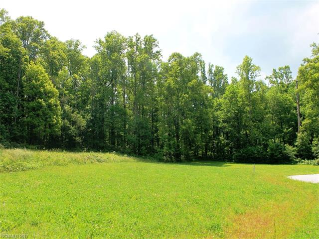 Level, easy build on this 1.63 +/- acres, underground utilities, off frame modulars allowed with Architectural approval. Expired septic permit on file.