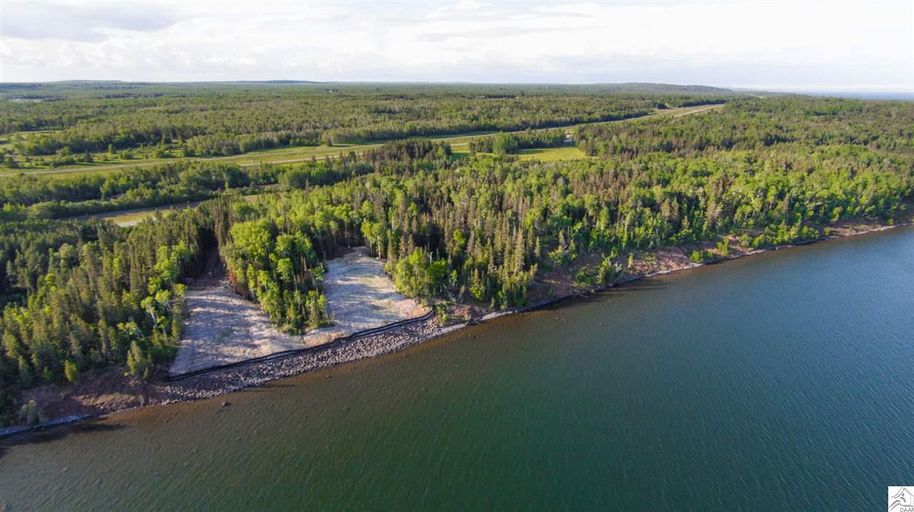 Lot 2 offers great lake frontage, mature trees, breathtaking view of Lake Superior and a ravine on one side for added privacy.  The shoreline has been stabilized and the clay bank has been removed.  Wonderful views. Huge price reduction!!!