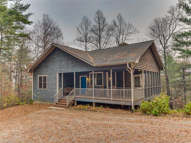 Cabin in the woods with mountain view on 8 acres. Finish basement to make more heating area space, already plumbed for bath. 45 x 45 Morton building with full bath, heat source, and electricity could be quest house or a barn. Morton building has its own septic system are parking. Most of 8 acres can be cleared for pasture or gardens. Easy accessibile to both Saluda and Hendersonville.