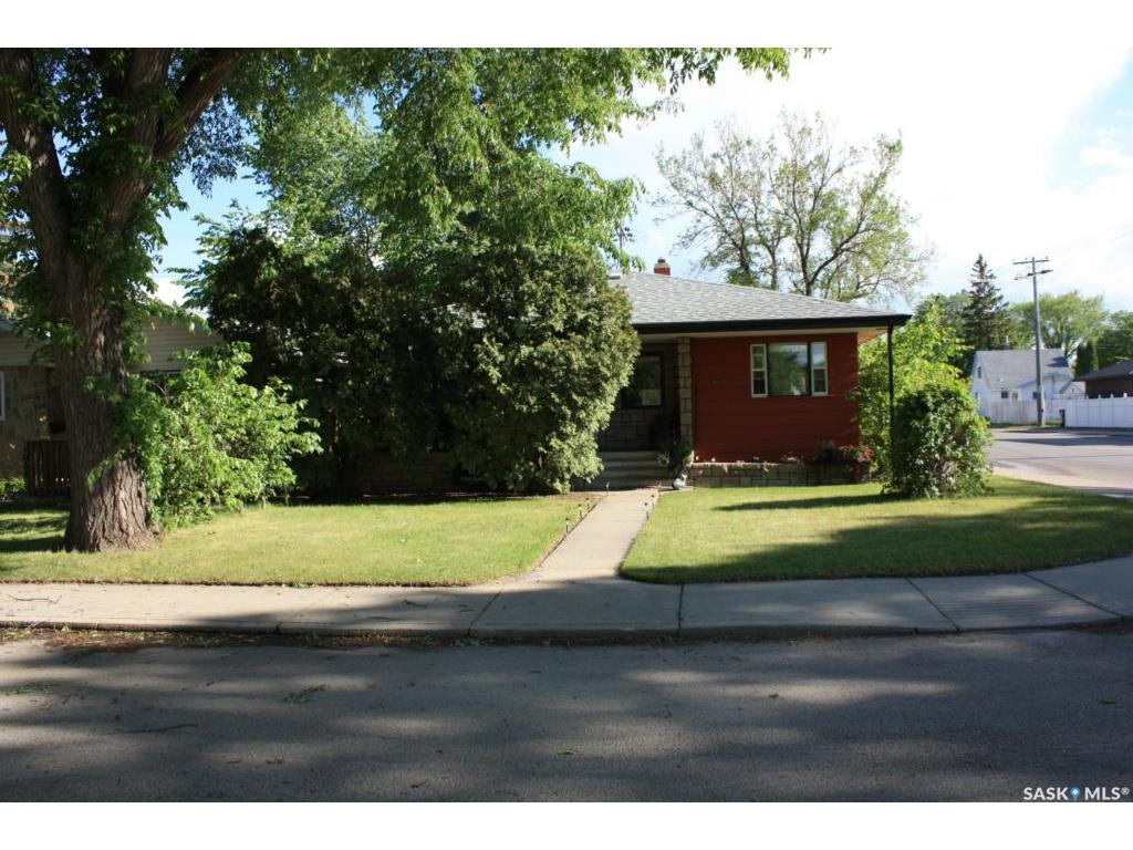 """Great Haultain location.  Easy access to University & Stonebridge amenities. 1032 square foot """"Retro"""" Bungalow.  Flooring throughout in 2015.  Flat ceilings, glass block in kitchen, all appliances included. Unique brick wall features in basement. Furnace & water heater older but in good working order.  SaskEnergy equalized $90/mo.. Shingles replaced in 2000. Single detached Garage. Listed at $359,900 mls Owner is licensed realtor."""