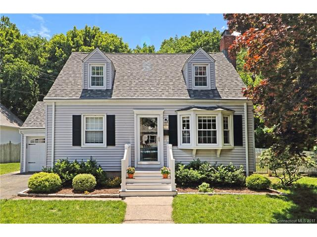 Charming Cape in the heart of  Spring Glen ,  large living room w/fireplace, first floor master br w/1/2 bth,hardwood floors, 2 tier trex decking overlooking beautiful  private level back yard,  backs to woods, formal dining room, e/I kitchen, you will enjoy the sidewalks , near bassett park and dog park, walk to parks and village, conv. to YALE , train,town center, library and parks, many shop's and restaurants, new roof on main house, professionally landscaped, new roof on main house