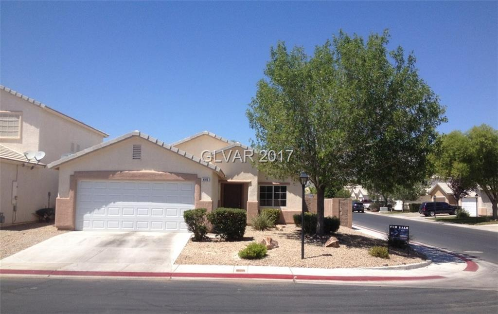 Stop The Car! Your search is over! *Single story, 4 bedroom home in gated development!* Spacious open floor plan on corner lot. Vaulted ceilings, crown molding, pedestal lighting above breakfast bar. Counter top microwave included. Great size backyard with so much  potential. Don't miss this one!