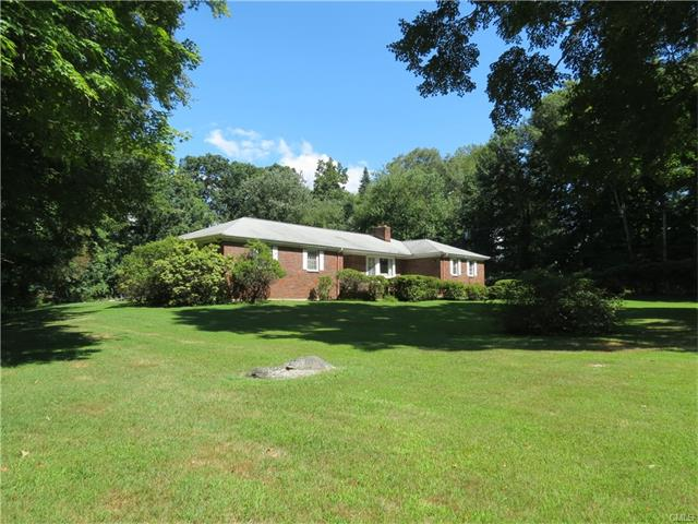 750 feet set back off of North Avenue  - Renovate or build on a LEVEL 1.20 acres. Spacious custom ranch with good bones. Oversized living room with fireplace, large eat in kitchen, generous bedrooms. Private rear lot that backs up to Melon Patch, Bedford and Wakeman Farms. A 2 minute walk to award winning Bedford Middle and Staples high!