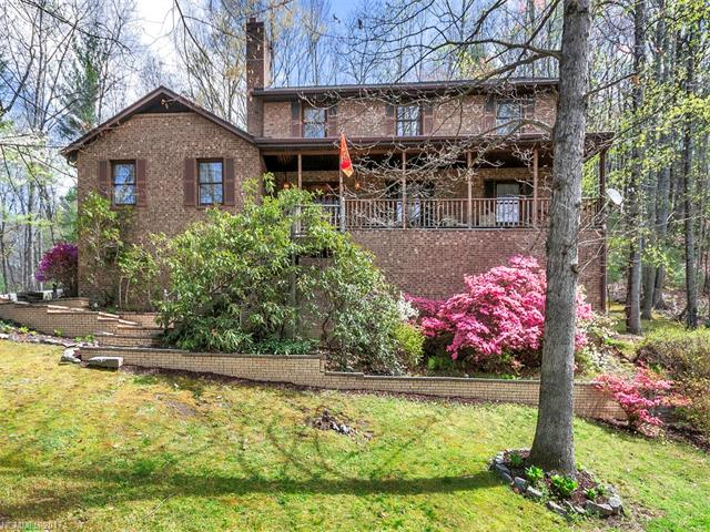 This beautiful, traditional home positioned on over 2 acres w/privacy, wooded surroundings & mountain views offers convenience to Hendersonville and I-26.  Enjoy your morning coffee overlooking your private, rear yard & wooded trees.  Ample parking in main-level garage and basement garage, in addition to an abundance of storage.