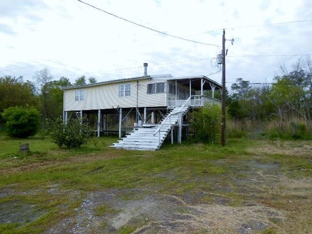 Rare opportunity to own a Lake Pontchartrain Water view homesite. Camp has large den and large bedroom. Bathroom has tub and separate shower. Front porch offers panoramic view of the Lake.