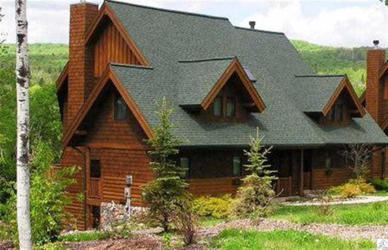 Well established ski in/ski out resort vacation property set within Lutsen Mountain Recreational Area. Ski, golf, hike, bike and more out your front door. 4BR/4BA townhome with stone fireplace, 2 gas fireplaces, bright open floorplan with cathedral ceiling, and amazing mountain view from deck. Updated kitchen with granite counter tops and stainless steel appliances. Newer Carpeting and paint throughout.  Includes all furniture,  flat screen TVs, DR furniture w/bar stools (solid hickory), Jacuzzi in Main Bath, Glass shower doors,  Deck furniture, , 5-person hot tub, central air, air exchanger, and ceiling fans throughout. Closest building to Moose Mountain lift.  Highly rated rental/revenue producer.