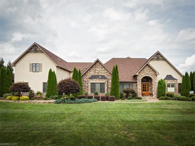 Beautiful Custom Home on 2.23 acres. Main floor living w/3BR, 3.5BA, gourmet kitchen w/high-end appliances, living room w/fireplace, family room, library/office, separate dining room & custom butlers pantry/bar area. Walk-in pantry & large laundry room. 350 sq ft sunroom w/FP & vented grill. 4-car garage on main. Upstairs in-law/guest suite w/kitchen, game room w/deck. Elevator & stairs to 2nd floor! Add'l 2-car garage/studio/RV garage/workshop.