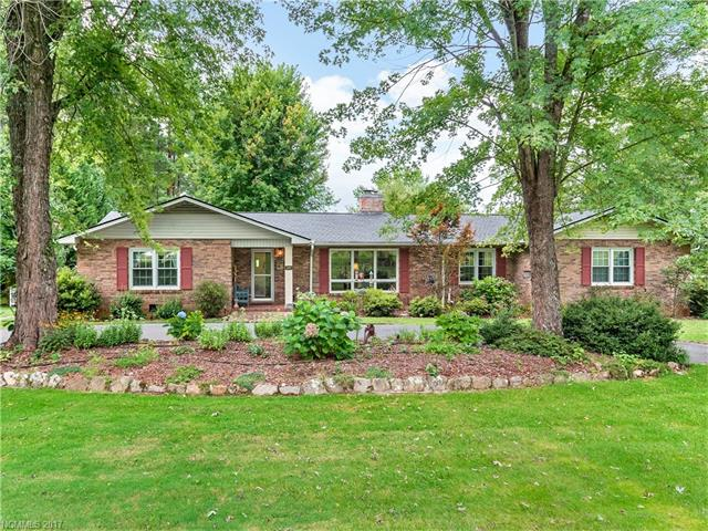 One level living in this wonderfully updated ranch across from Etowah's Golf Course. Outstanding kitchen w/ center island, Schuler cabinets, built-ins, granite counters, stone tile & wood floors with fireplace in breakfast space, a convenient butlers pantry & laundry. Outstanding Great Room with cathedral ceilings, wood floors, & fireplace with access to a wonderful covered lemonade porch.  Fenced yard has an arbor, two gates, a lovely garden space & shed. A perfect place to relax & enjoy life.