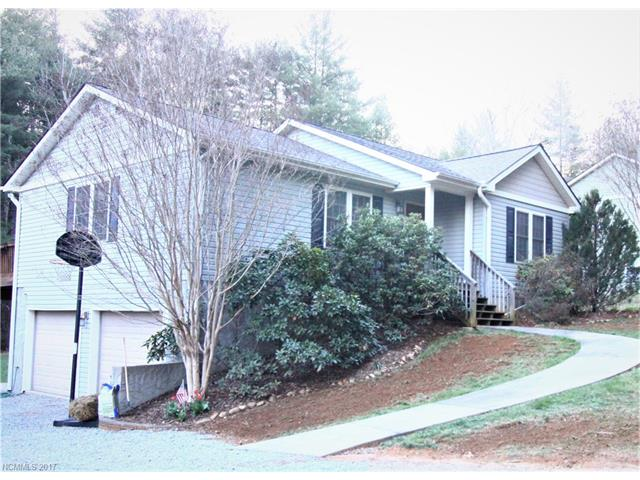 Beautiful 2000+sqft home filled with so many desirable features. Great location with mountain views. Less than 10mins to Main St. Hendersonville, 7 mins to Carl Sandburg, 15 mins to Dupont State Forest, 20mins to Brevard. Spacious & open with hardwoods on main level, berber in all bedrooms, tile & marble cntp in all baths. Finished basement that entertains so many options. Large kitchen w/stainless appliances. Large back yard with swing set.
