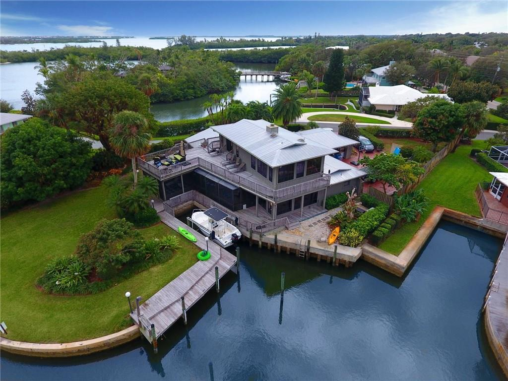 Tropical Oasis! Spend your evenings relaxing on your wrap around balcony enjoying exquisite views of the Indian River. Open your eyes to the beautiful sun rising over the Indian River right from your second floor master suite. Enjoy living in a one-of-a-kind location with protected dockage for your boat. A boater's dream - just minutes to the Inlet and world-class fishing. Nature lovers will relish the abundance of manatees, fish, water birds and rich fauna found all through the meandering waterways around this Key West style home in the Archipelago of Sewall's Point. Paradise Found.  Being sold below recent fair market appraisal of 1.1M.  Seller willing to share appraisal.