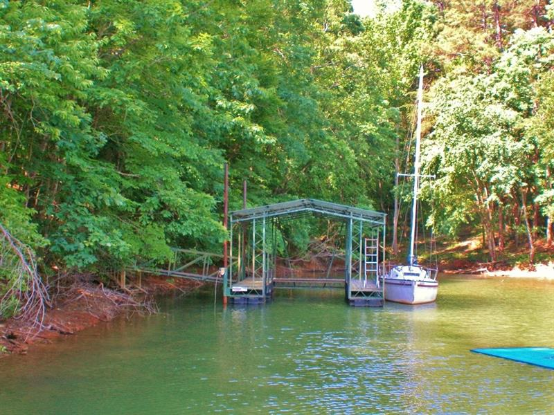 Very well priced lake lot with single slip dock in place. Quiet neighborhood. Excellent location on Lake Lanier.