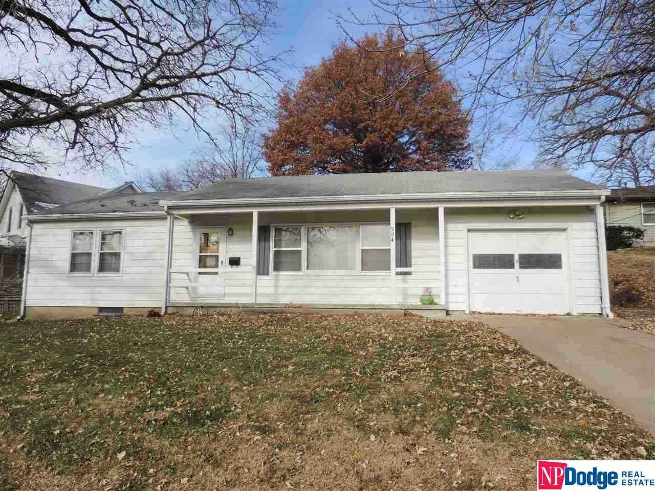 Lovely 2 Bed, 2 Bath, Ranch home located close to Main St has so much to offer!  Large Kitchen with custom cabinets, pantry and eat-in area. Separate Dining Room off of the Kitchen was once the 3rd Bedroom. Large Living Room with built-in corner cabinet and wood floors under the carpet. Good size Master Bedroom has 2 dual closets. There is a separate entrance from the Garage to the Finished Basement which includes a 2nd Kitchen, large finished area, ¾ Bath, lots of closets and storage space. This home also includes no maintenance steel siding, spacious 1 car Garage with additional storage space and built-ins, and a shed. Furnace and A/C new in 2011. Appliances in both Kitchens stay.
