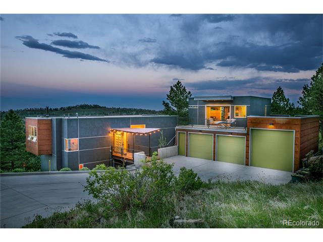 This unique, contemporary home is located within Reed Ranch Community, a gated mountain enclave with paved road access. Home has been built for privacy on a wooded 35 acre lot with evergreens, natural growth; meadows, rock outcroppings, historic archaeological spaces and east facing for scenic sunrises and city lights. Serenity of mountain living with convenience of downtown Boulder 10 min away. Open floor plan.