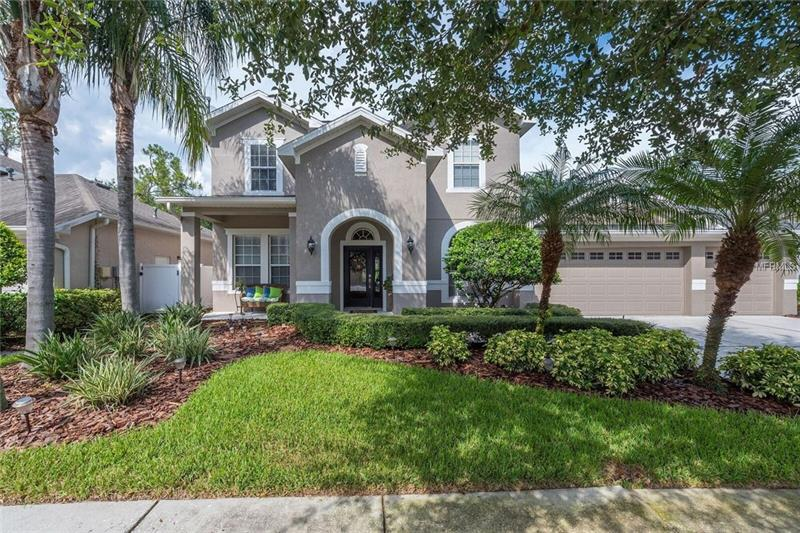 Gorgeously upgraded Executive residence in the exclusive gated community of Buckingham in Tampa Palms. A stunning 3,102  SF with 4 bedrooms, 3 ½ bathrooms, office,large  bonus room  three car garage, large  kitchen overlooking large family room  granite counters, custom wood cabinets, professional style gas cook-top, double ovens, and a butler's pantry. This home has all the things that you could be looking for. Upstairs Bonus room , large walk-in closets, dual vanities, shower and tub,landscaping and deep conservation in the back .  Convenient to shopping, restaurants, USF,  Come and See It.