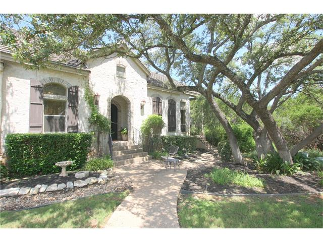 Fredericksburg French style Texas farmhouse in the Hills of Lakeway! 1 story, very private home tucked away among gorgeous oaks on a cul-de-sac in one of the most lovely sections of the Hills gated golf course country club community. Well designed with casually elegant living spaces, lodge like great room with beamed ceiling & an abundance of built-ins throughout! Private, peaceful patio overlooking greenbelt & trees with golf course & gorgeous places to explore a short walk away!
