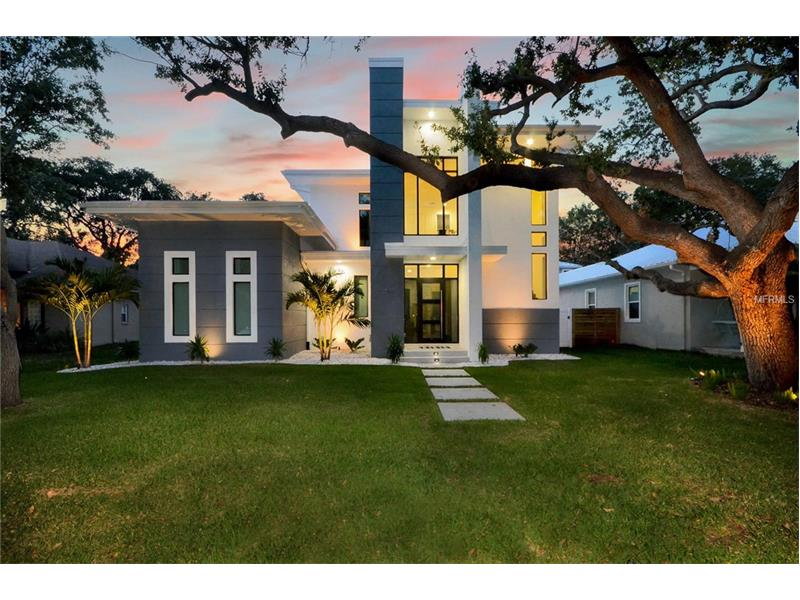 This architectural Modern Masterpiece is home to purity of design and is a one of a kind with Resort Style Living! A Commanding presence on quiet oak canopied street in South Tampa, just .5 mile to Bayshore Blvd, Ballast Point Park/Pier and Tampa Yacht Club. Property stretches between 2 streets, with oversized 2 car garage rear access attached to main home via covered breezeway. Storefront glass windows highlight the floating concrete & glass staircase allowing natural light to pour throughout the soaring 24' grand foyer. 2nd floor Overlook with Glass Railing captures the true essence of the clean lines that are a running theme throughout. Blending Indoor to Outdoor living with ease through 10' pocket sliders out to the Silver travertine clad Covered Lanai, Open Air Lanai wired for cable TV, Salt Water Pool, Outdoor Shower, Pool Bathroom and Large Lawn. The Downstairs Master Retreat has views of the Rear Yard and is equipped with custom built-in His and Hers Wardrobe with a Serene Master Bathroom. An additional bedroom suite and laundry center rounds out the 1st floor, with heightened 12' ceilings. 3rd and 4th Bedrooms share a jack n Jill bath on the 2nd floor. Italian made high gloss cabinetry, Stainless Steel Bosch Gas Appliance package, all Kohler plumbing package, Carrara inspired durable Quartz Counter tops throughout, LED recess lighting, Warm Gray Hardwood floors throughout (minus wet areas), Custom Solar Roller Shades throughout and Designer Light fixtures finish off this Jewel of Ballast Point.