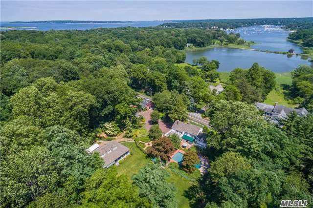 Rare Opportunity To Own A Compound On Over 3 Acres In Lloyd Harbor. Property Includes Restored Colonial W/ Amazing Wine Cellar, Barn With Large Loft For Office/Gym/ Bth/ Work Space/Greenhouse, Separate Designer Guest/Entertainment House ( Built 2000)With Large Porches,  Perennial Gardens Beyond Belief W/ Pond And Stream, Gunite Pool And Patios. Village Beach/Mooring/Camp