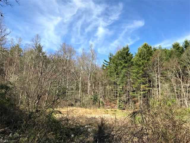 Wooded acreage three pins with nice creeks and mountain views, access off narrow two lane road very close to DuPont Forest.  Being sold as a package could be broken up for 3 parcels.  R3 Zoning acreage calculated from original development plans buyer to confirm with survey.