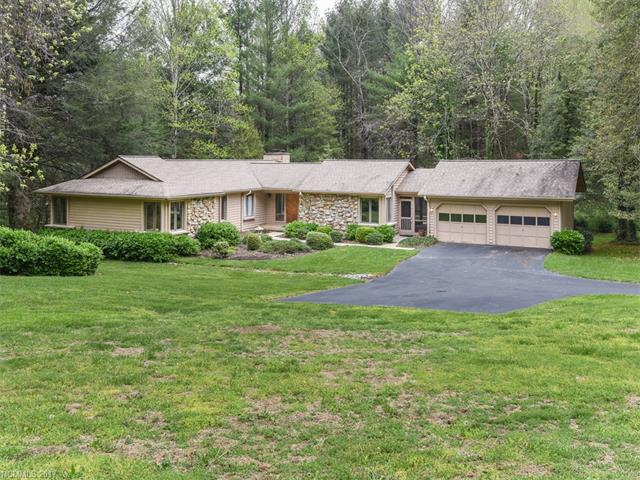 Enjoy one-level living in this private 3BR, 2BA ranch home with a wonderful floor plan. Nice setting with a small creek and forested backdrop at the end of a cul-de-sac. Generous great room with a stone fireplace. Lots of windows and natural light. Comfortably sized kitchen with sunny breakfast nook.