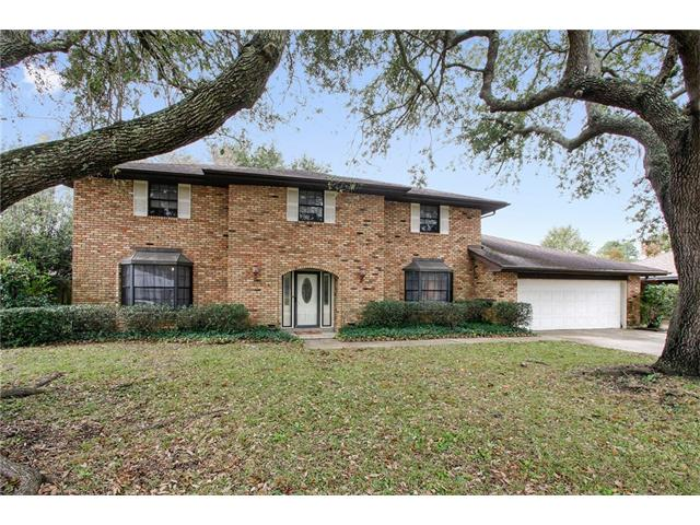 This large house is framed with beautiful oak trees and mature landscaping that will invite you home day after day. Step outside the back door to an enormous patio and deck area for all of your outdoor entertaining & a sizable back yard to create many memories with family and friends. 4 bedrooms, 2 full baths, and 1/2 bath for your guests will accommodate many. Don't miss the additional workshop room connected to the garage. Oversized laundry room has cabinets, utility sink, and a door to the backyard.