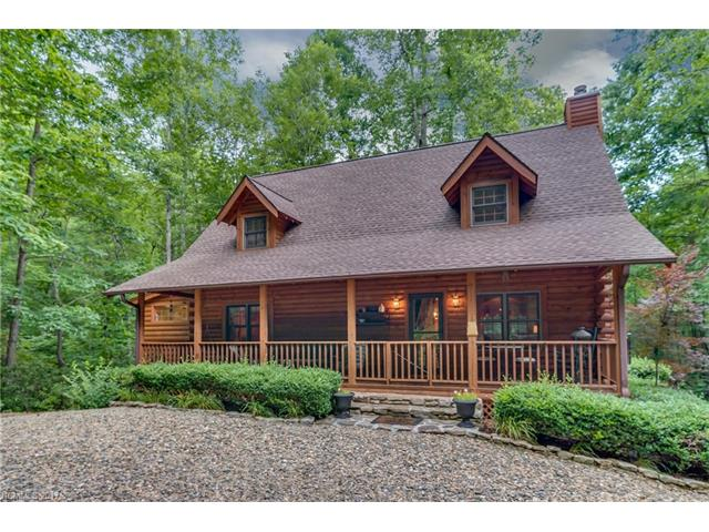 THIS is a beautiful log home, a perfect mountain home!! Park like setting with beautiful lawn bordered on 2 sides by stream. Level circular drive leads to the covered front rocking porch. Soaring ceilings with loft overlooking a grand fireplace combine to make this so much more than a cabin. Open floor plan great for entertaining with large sunroom. Master on main and 2 bedrooms on 2nd level. The rear deck gives privacy and a true mountain feel.