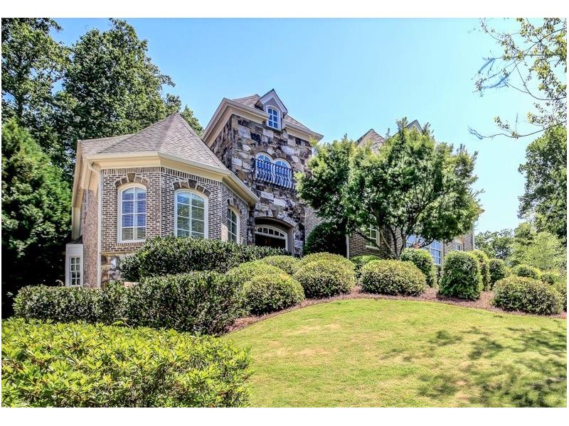 WOW! Gorgeous traditional B'khvn home! Kitchen feats s/s apps,GRANITE counters,island,walk-in pantry, & butler's pantry. Formal din rm perf for entertaining! Bright 2-story fam rm boasts BUILT-INS & cozy wood burning FP. Relaxing SUNROOM is perf for reading & add'l living space! Office offers quiet retreat on main lvl. Master has gas FP,CUSTOM built-ins,jetted tub,& walk-in closets! Add'l bdrms are all SPACIOUS & light. Basement offers FINISHED fam room,bth rm,& add'l space for storage/future liv space. PRIVATE & serene backyard! Conveniently close to schools & parks!