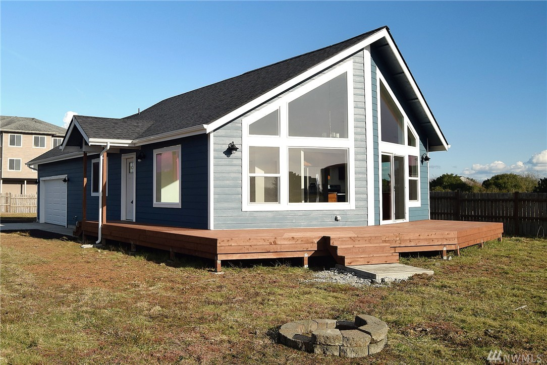 Located in Ocean Shores premier neighborhood and built by established local builder. This perfect home is located on a fully fenced huge lot that has 80 feet of water frontage and 12,000 Sq ft of land. Dock is installed and there is a partial ocean view. Located in a zone that allows for residential use or nightly rentals. This home has ultimate privacy that cannot be beat with smaller lots. Just one block to a sandy beach access have the best of both worlds.