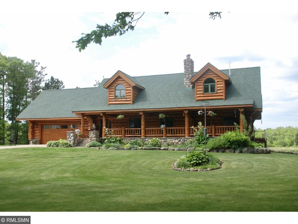 Must see custom log home w/amazing detail. 40 wooded acres w/water views. Vaulted ceilings throughout the home. 2 wd burning fpl's w/flr to ceiling stone work w/custom mantles. In flr heating-surround sound throughout the home. Main flr master suite w/private BA, and a walk out to the back deck. Custom kit w/field stone ctr island, granite countertops, hickory cabinets, w/a great water view. Loft overlooking FR w/2nd master suite on 2nd flr w/priv balcony.Bonus rm above the gar. 60x40 pole barn