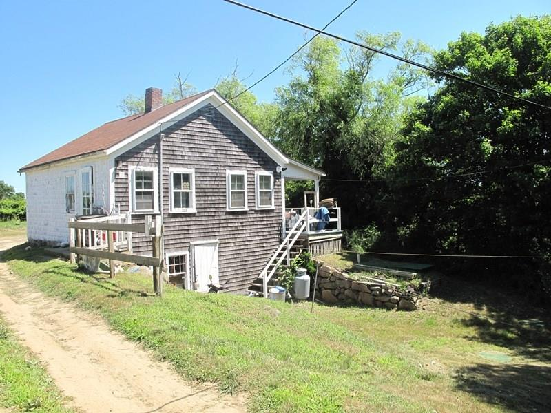 "Wonderful opportunity for a buyer with carpentry skills to own a piece of Block Island.  Nicely located near the town, school and Medical Center.  Walk to town and the Mohegan Bluffs. Nice views over Conservancy land.  Small shed on property.  Sold ""as is"""