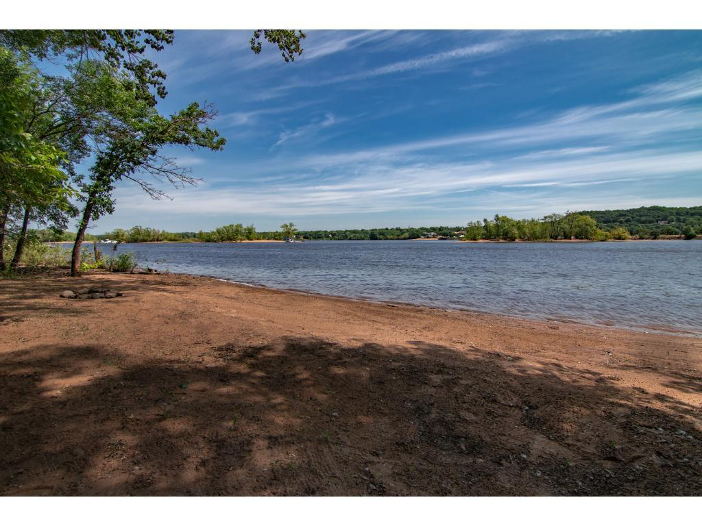 Beautiful home situated 200' high on the St. Croix River bluff w/breathtaking views & private access to the St. Croix River. Handy tram offers easy access to the sandy beach w/150' of shoreline, perfect for boating & lots of summer fun! 2.04 acre lot w/mature trees & grand circular driveway. Open flr plan w/10' vaulted ceiling. Master BR w/private 1/2 bath. Large 28x28 deck. WO LL w/in-law suite! Attached 2-car garage & detached 1-car garage w/large workshop area. Easy access to I-94 & Hudson.