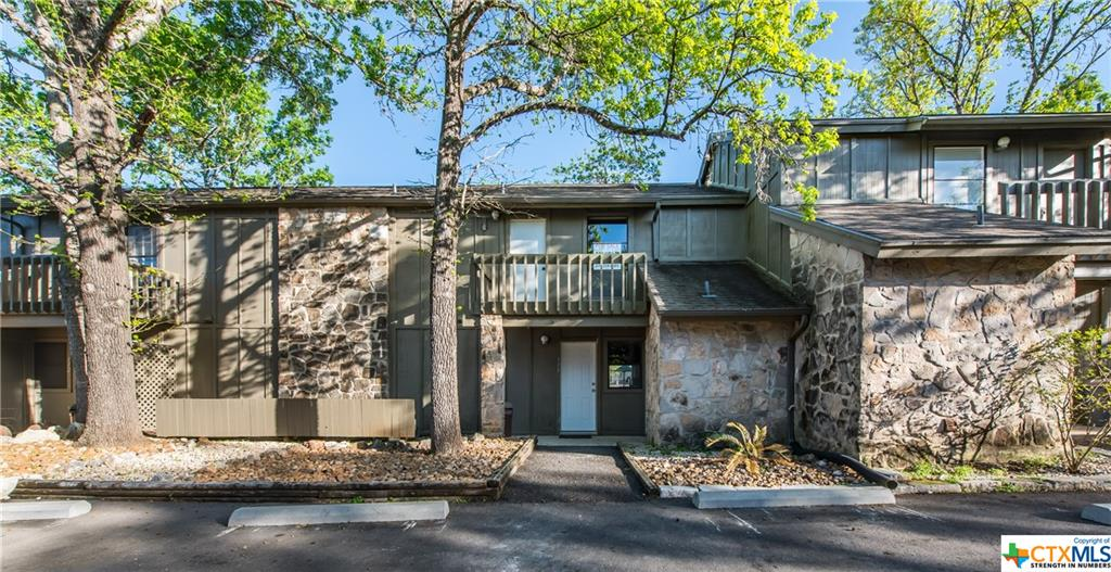 Remodeled with upgrades to include granite counter tops, stainless appliances, laminate wood flooring, New Interior Paint and many other pluses. 3 bedroom 2 bath Condo in T Bar M with great views of the facility.  The condo is an ideal location for New Braunfels, just down the road is an HEB complex and easy access to loop 337 / IH35. Condo is within walking distance to pool complex & tennis courts just out the back door.
