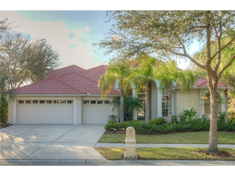 Seller MOTIVATED!!!  Beautiful four bedroom, four bath home with den, bonus room, three car garage, pool and spa located in the gated section of the Enclave at Arbor Greene in New Tampa.  Beautiful oversized lot overlooking a pond, conservation and near the community playground. The location is only enhanced by the sunset over the custom pool with heated spa in a paver-tiled lanai. The exterior has a stunning Mediterranean elevation with tile roof and mature landscaping all around. This home has many tasteful designer upgrades including plantation shutters, crown molding, elegant columns, beautiful arches, art niches, a wonderful gourmet kitchen with walk-in pantry and a mitered glass corner window in dining area. The kitchen features granite countertops and backsplash, a smooth top range, microwave, built in refrigerator, custom glass cabinetry and a desk area. This home features a split bedroom plan. The master suite has decorative columns and can accommodate a sitting area. It features two walk-in closets and a luxurious master bath complete with jetted garden tub, separate walk in shower and dual sinks. Upstairs, a bonus room with full bath and additional closet can be the perfect playroom or home theater.  The community of Arbor Greene offers many wonderful amenities including a gated entry with 24-hour guard, two pools, fitness center, Har-Tru tennis courts, basketball courts, and community parks.