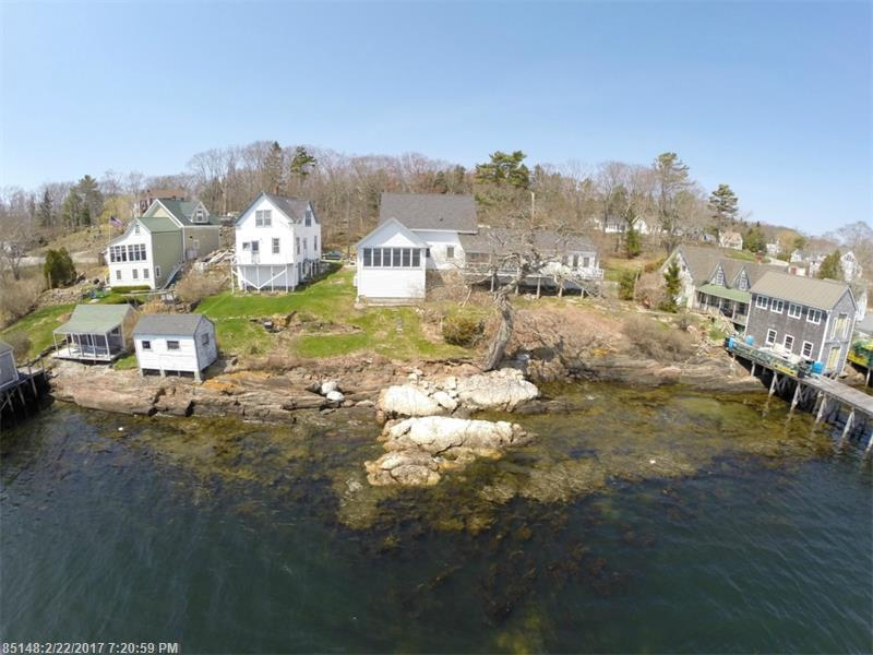 Beautiful 1800's New Englander Cape with water frontage on Cundy's Harbor right in the village so you can enjoy walking to the local store, library, restaurants and community events.  Beautiful views of the ocean where you can watch the boating activity from your deck.
