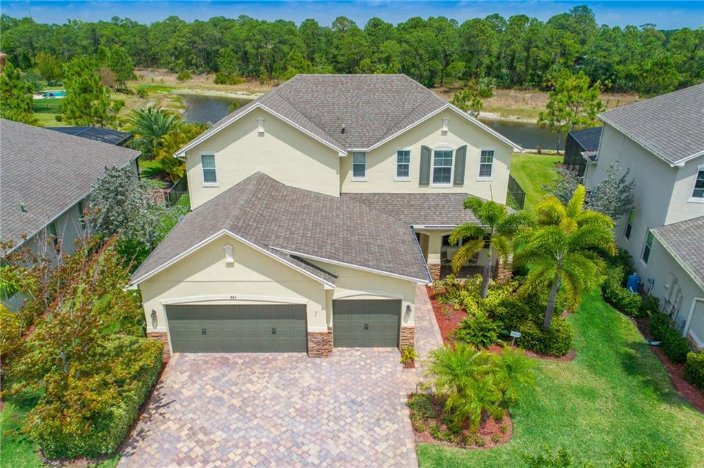 Welcome to Copperleaf! This stunning and well kept family home features 4 bedrooms, 3 baths, a 3-car garage and a custom heated saltwater pool on a premium lot overlooking the lake and the preserve. Interior features include beautiful 42 in. maple cabinets in the kitchen with granite and stainless steel appliances. Owners have added crown molding and chair rails throughout to really show off this home! Newer carpet installed upstairs as well as laminate flooring in the downstairs bedroom. Great entertaining home inside and out as the back patio comes with a custom heated Pebble Tec surfaced fenced-in pool with an electric pergola roof providing you with shade and/or it can be closed tight to block out rain! Bring your fussiest buyers! Also note that the exterior of the home was just repainted in recent months. Check out video tour! https://youtu.be/25WSjUh2UHc